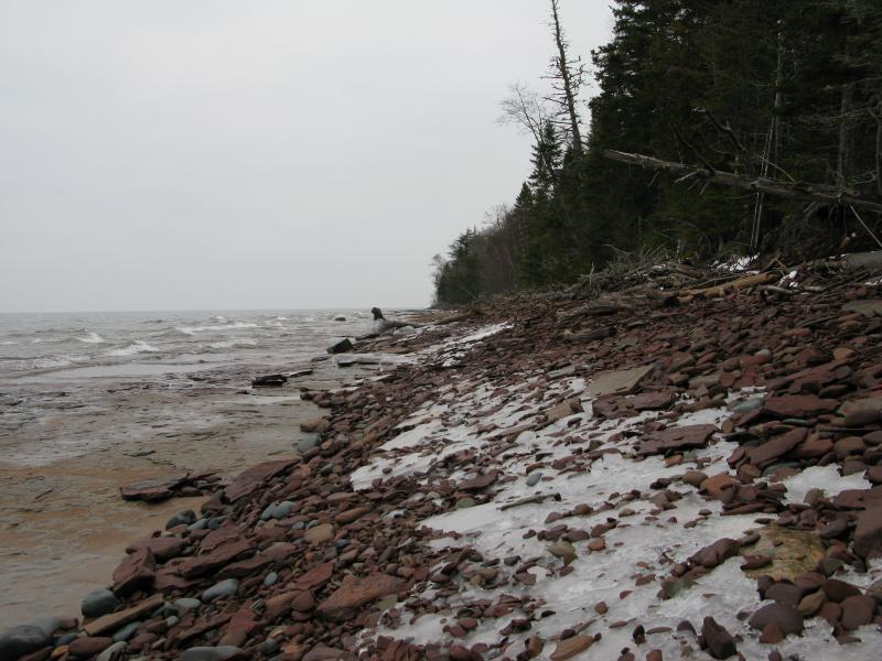 Frozen rocks coating the shoreline