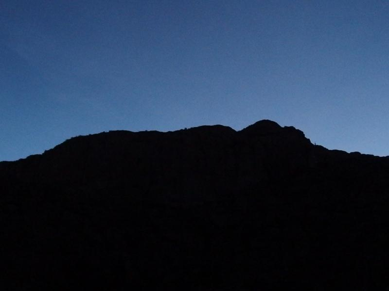 Dim blue sky over Malapais Mountain