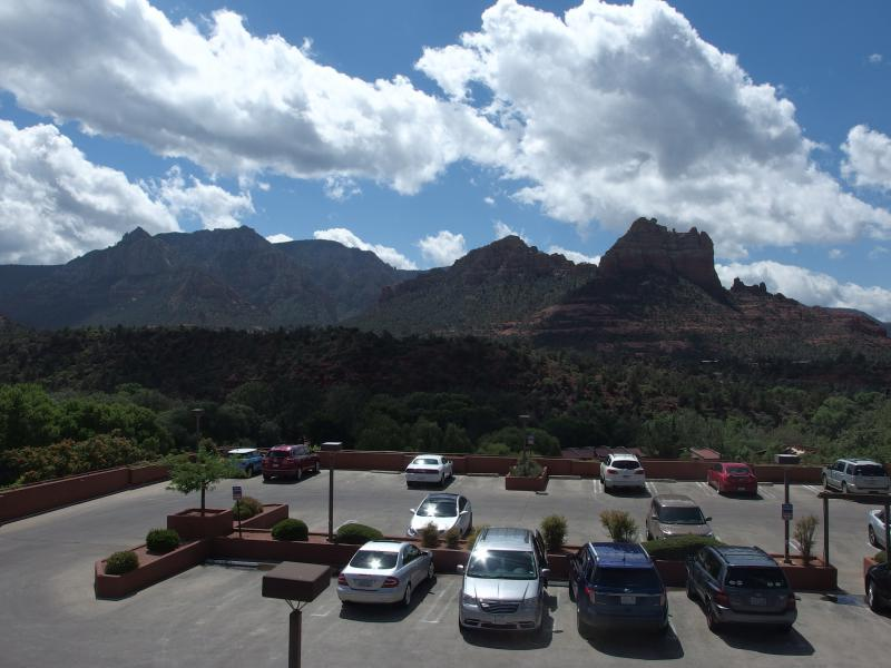 Rugged hills and mountains beyond tame parking