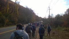 Long line of hikers on the way to the trailhead