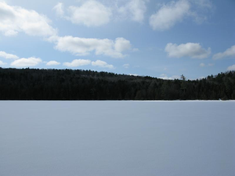 Ice Covered Cliff Lake