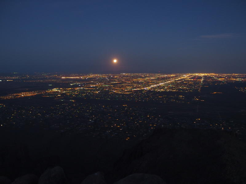 The full moon dropping down over Phoenix