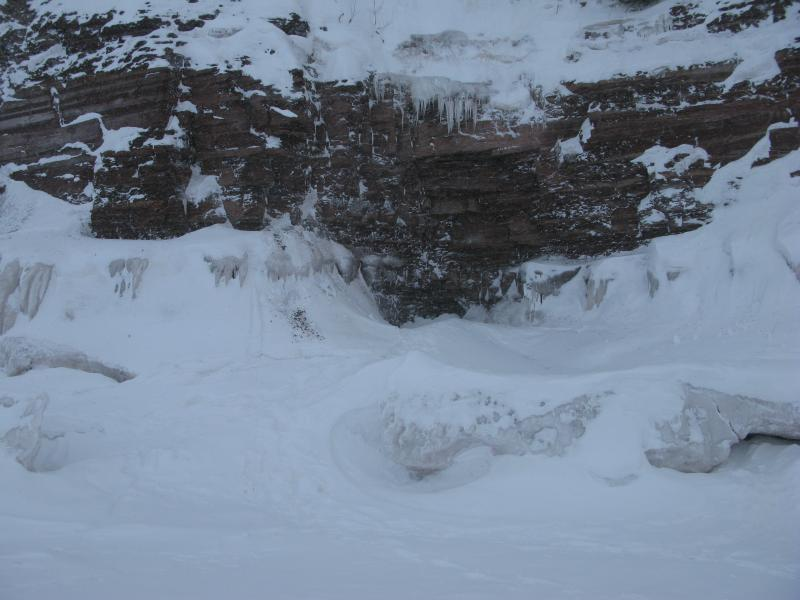 Sandstone cave fringed with ice