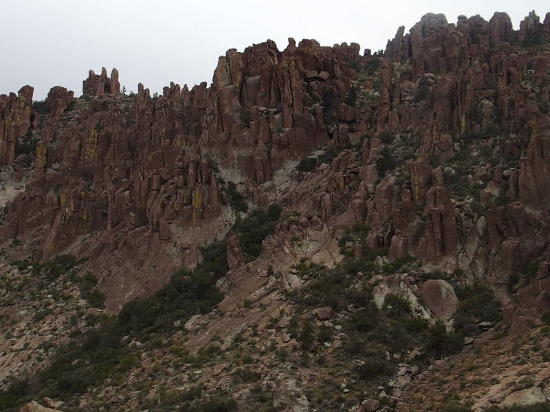 Rugged rock walls to the west of the canyon