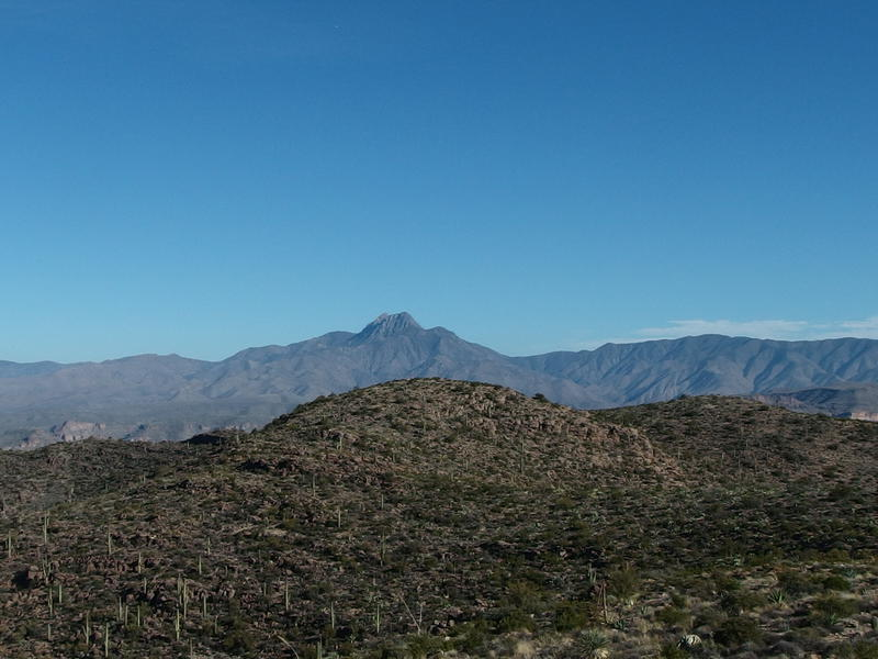 Four Peaks poking up above the low hills