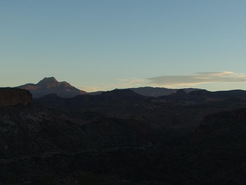 Sun beginning to shine on Four Peaks