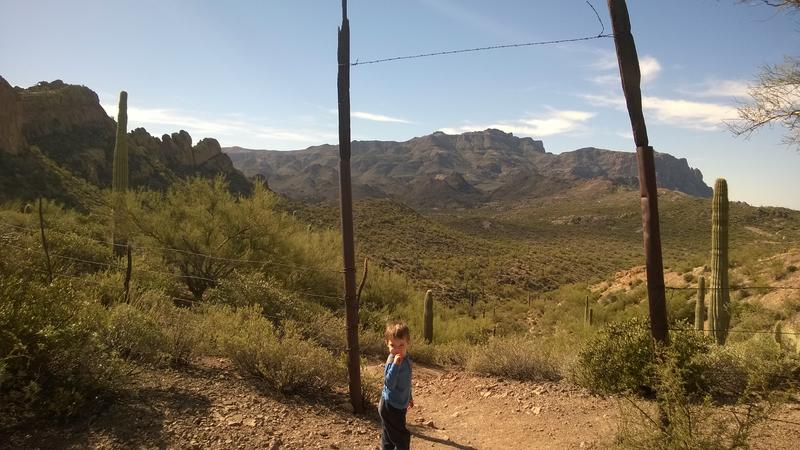 Noah pausing at the old ranch gate