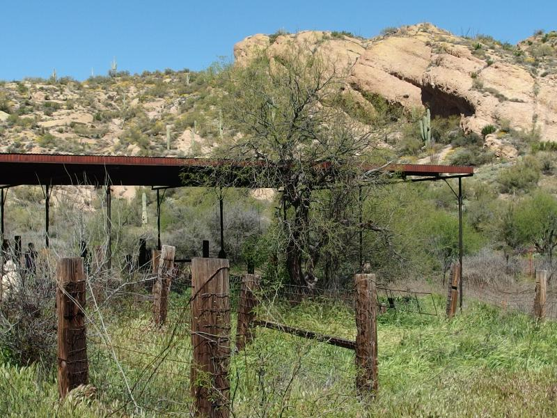 A rusty, shaded shelter at the ranch