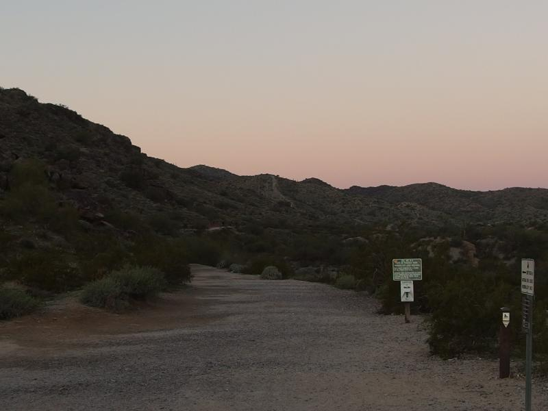Rosy predawn light over the trailhead