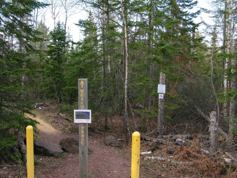 Posts and signs at the trailhead