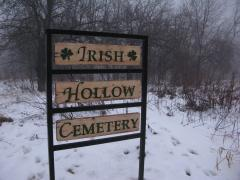 Aged sign for Irish Hollow Cemetery