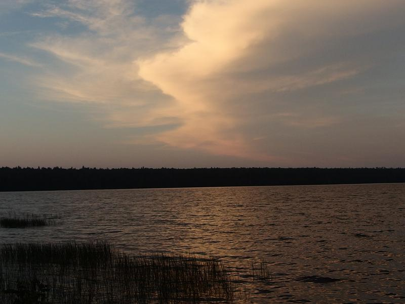 Bright evening clouds over the lake
