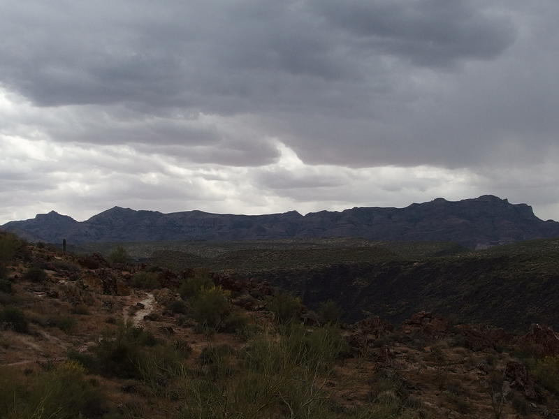 Thick grey clouds over Superstition Ridgeline