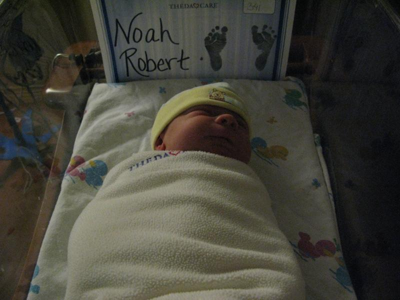 Swaddled Noah and his huge feet