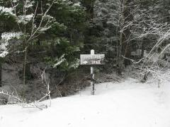 Snowy sign for the trailhead