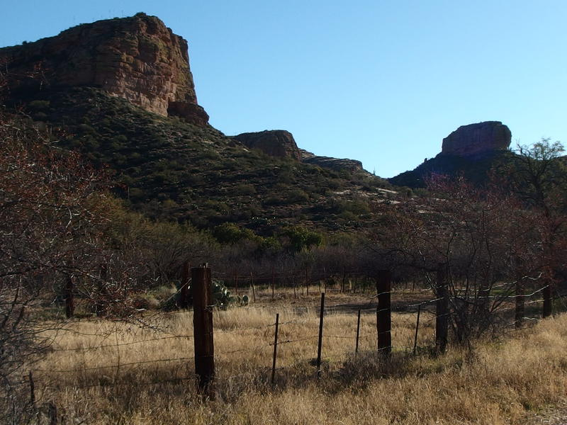 Tall bluffs above the old, rusty fence