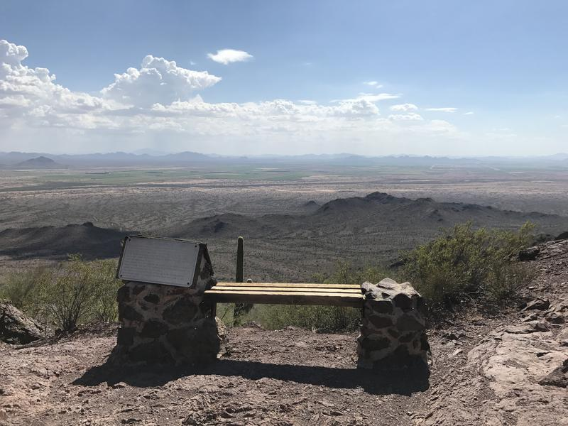 Bench and plaque at the saddle