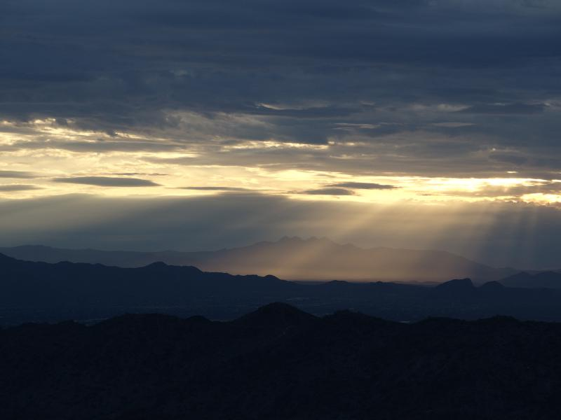 Sunrise shafts over Four Peaks