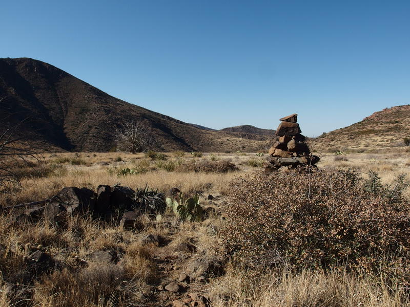 Big cairns across the barren grasslands