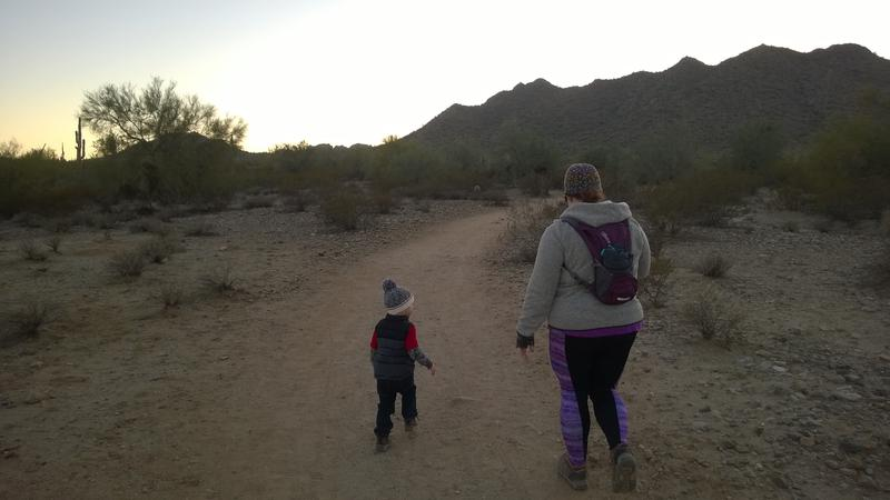 Katie and Noah walking down the trail