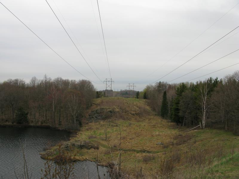Powerlines stretching over the point on the lake