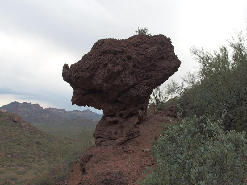 Rock balanced above the trail
