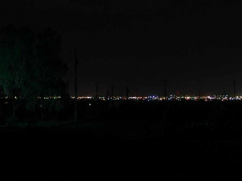 Distant city lights under a dark sky